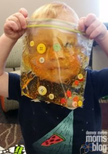 Peering at mama through his sensory bag!