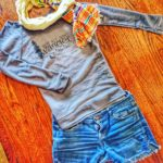 Make your own shorts by cutting off a pair of jeans. Pair with a light 3/4 length off the shoulder top and summer scarf and you have yourself the perfect summer sunset attire