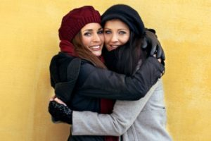 two-women-hugging