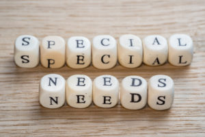 Special needs text on a wooden cubes on a wooden background