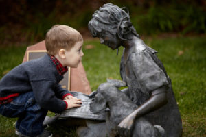 boy looking at statue